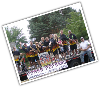 Image of Portland Oregon's Power Pep Band standing on a trailer.