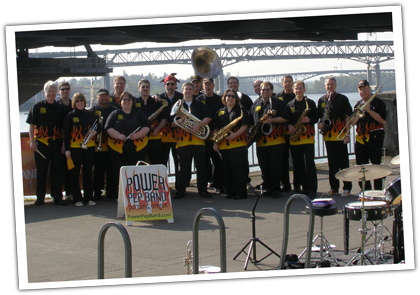 Image of Portland Oregon's Power Pep Band Posing under a bridge.